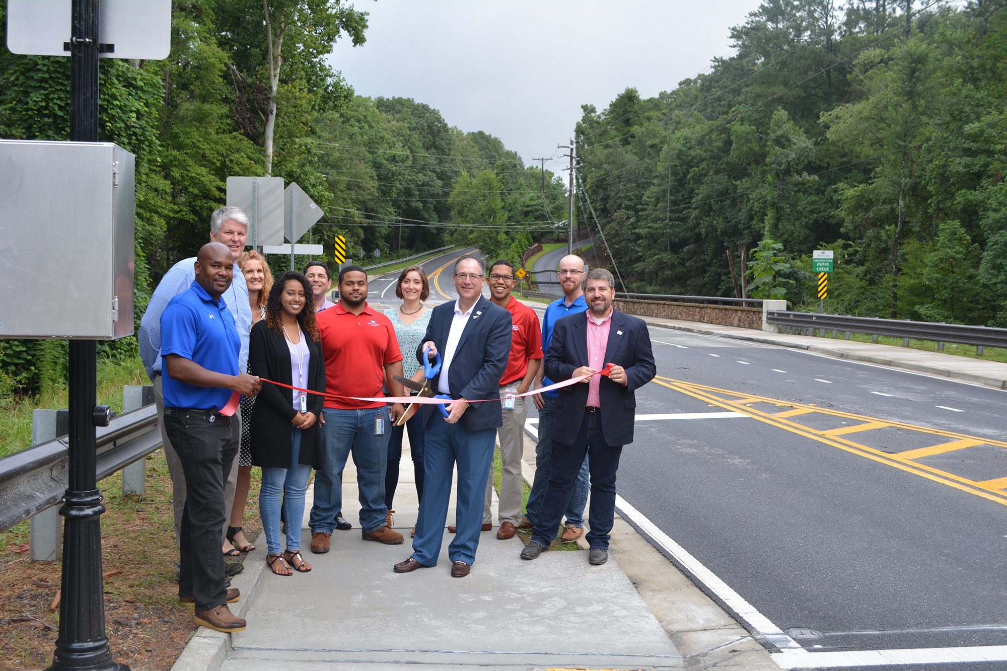 City holds ribbon cutting for Parsons Road sidewalk project