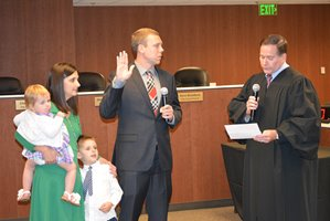 Chris Coughlin swearing in